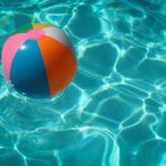 Swimming pool with inflatable ball