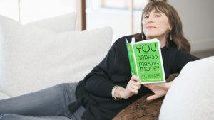 author holding book for You Are A Badass At Making Money review
