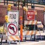 Detour signs representing how do limiting beliefs harm us