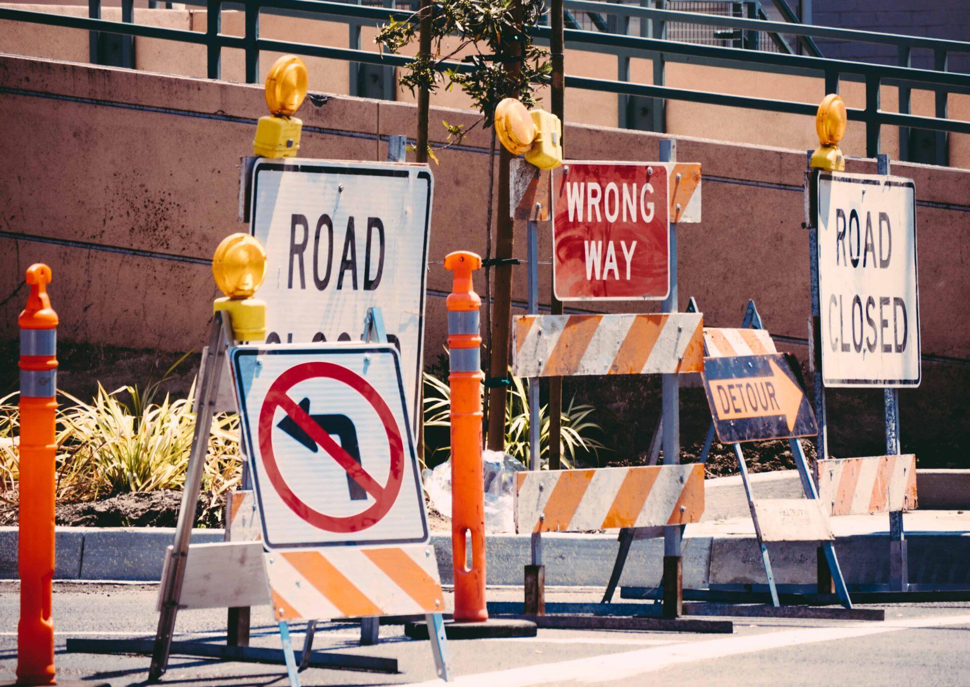 Detour signs representing limiting beliefs