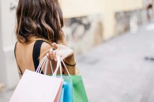 Woman with shopping bags as she goes impulse buying