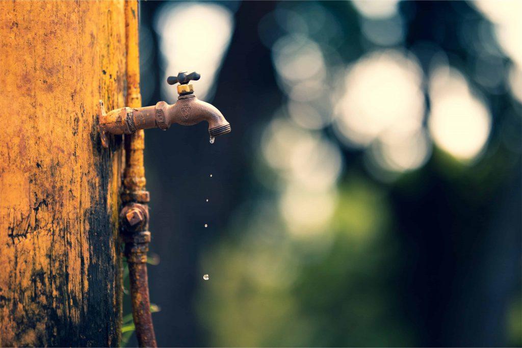 Leaky faucet representing budget leaks