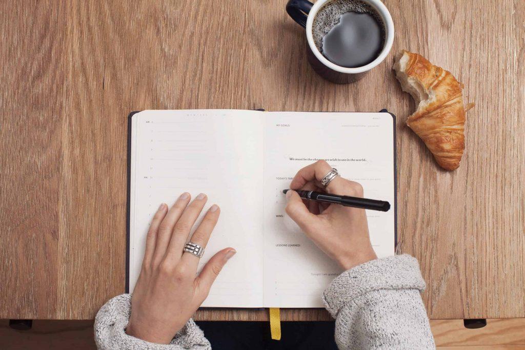 A woman creating a written life plan
