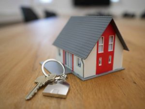 House and keys representing question why should I check my credit report regularly?