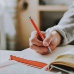 Writing in journal to learn 5 daily money habits