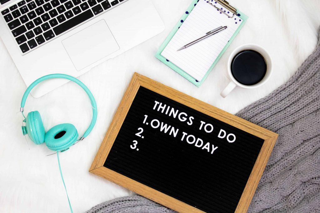 Laptop, headphones, and financial crisis checklist