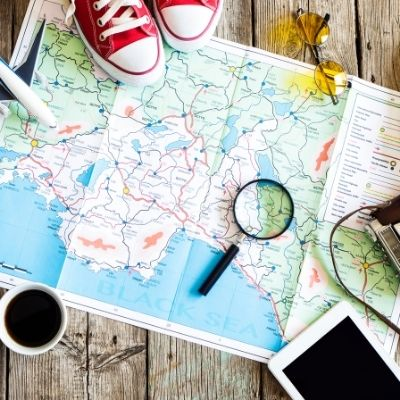 Sneakers, map, magnifying glass