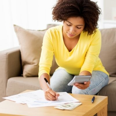 Woman paying off debt
