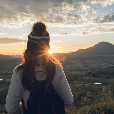 Woman looking into sunrise