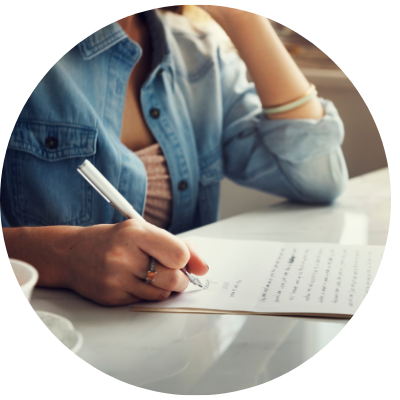 Woman writing letter to future self