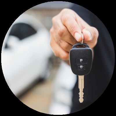 A person handing over car keys