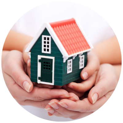Two hands holding a toy house
