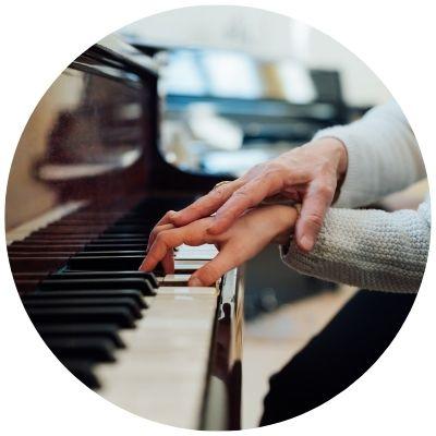 Woman teaching piano
