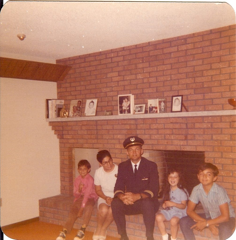 Family picture in front of fireplace