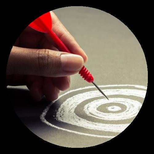 Woman placing target on bullseye
