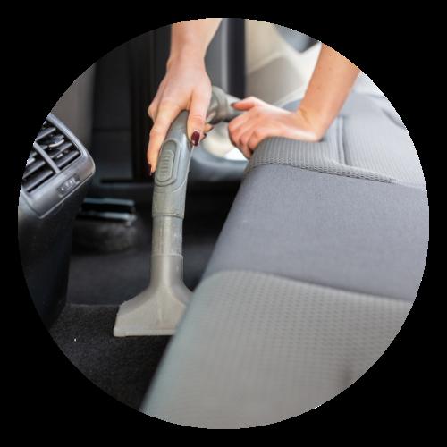 Woman vacuuming car