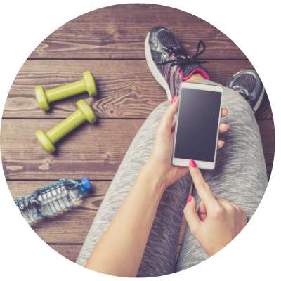 Woman on phone with exercise equipment
