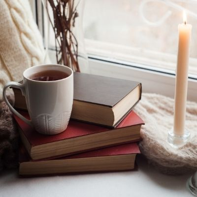Cup of tea, candle and book