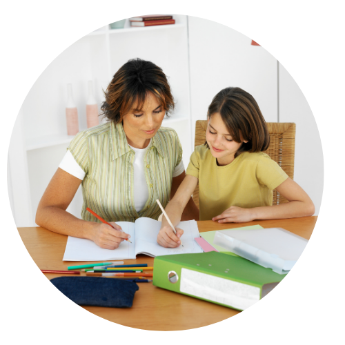Woman tutoring young girl