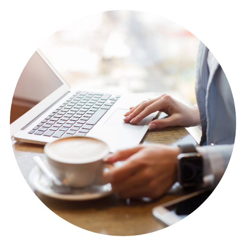 Woman investing on laptop with coffee