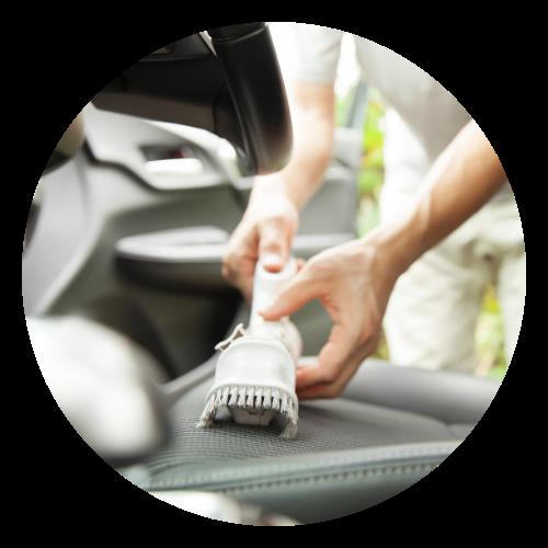 Woman vacuuming a car