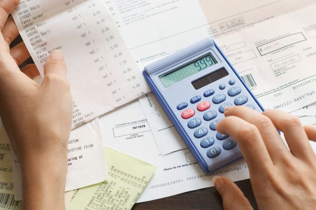 Woman calculating 3 types of expenses