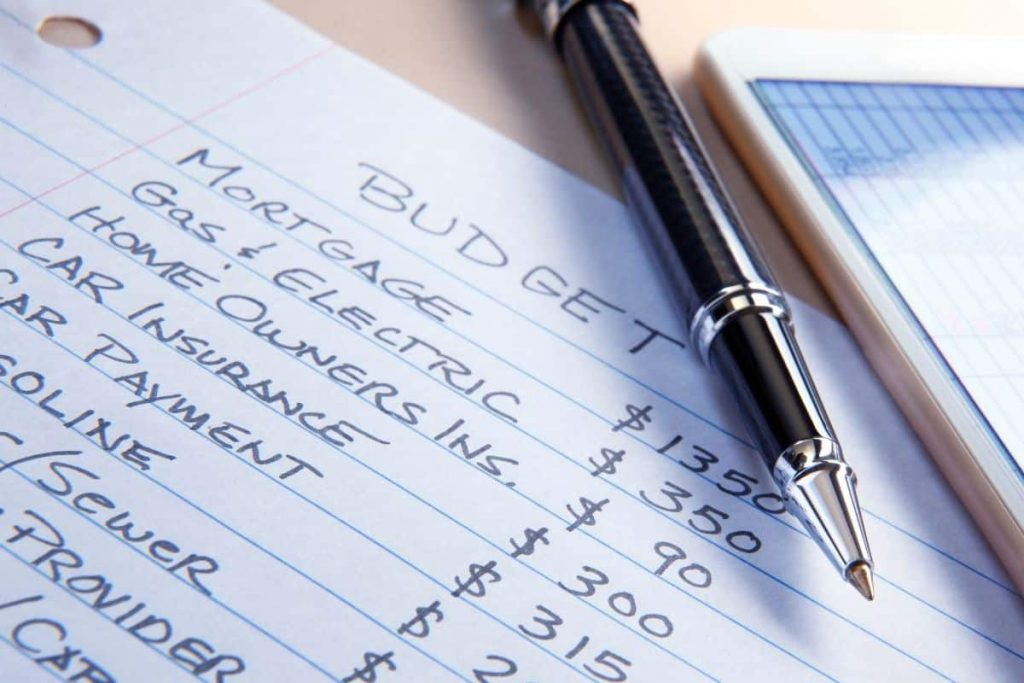 List of budget categories with pen