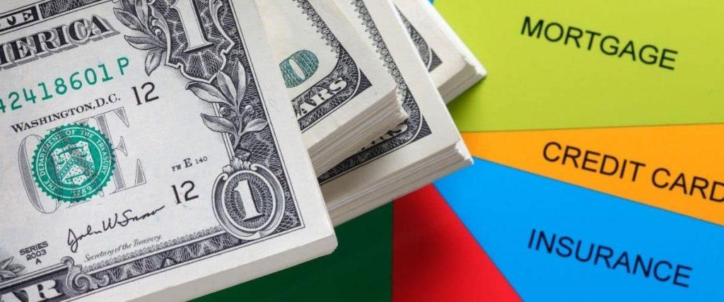 Dollar bills on top of budget graph