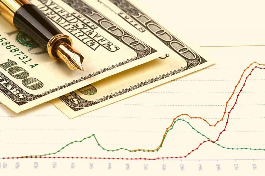 Liquid net worth graph and pen