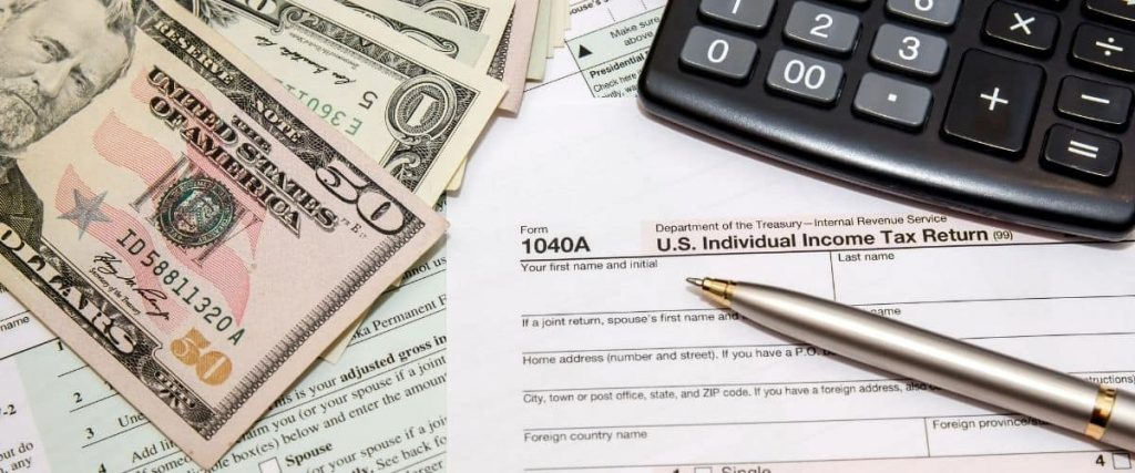 Federal tax form, calculator, and cash
