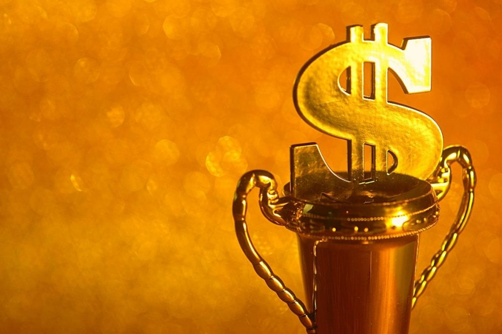 Money Saving Challenges trophy and dollar sign