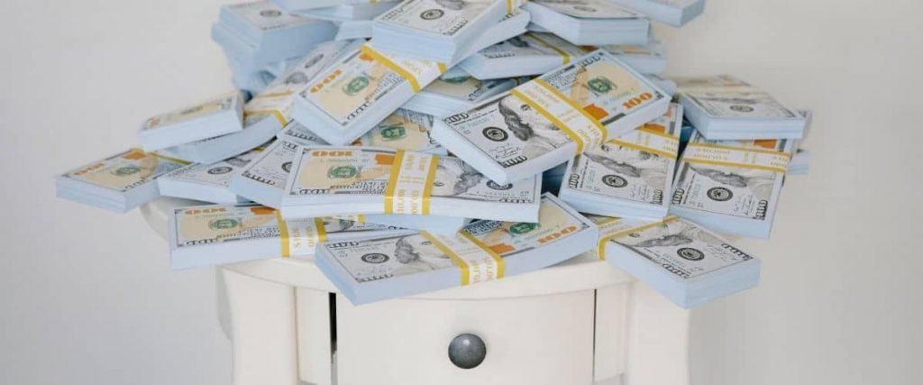 Pile of cash on top of table