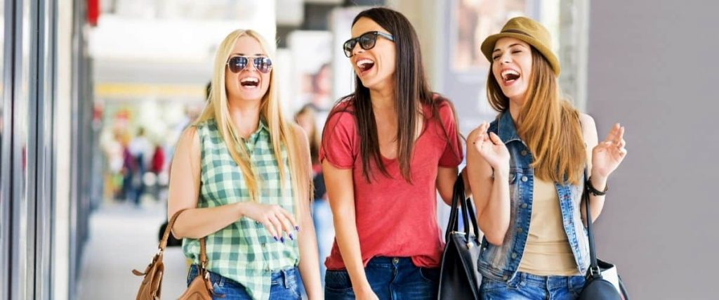 Girlfriends having fun shopping together