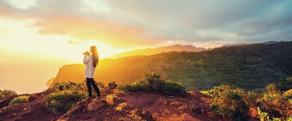 Woman on mountain during sunrise