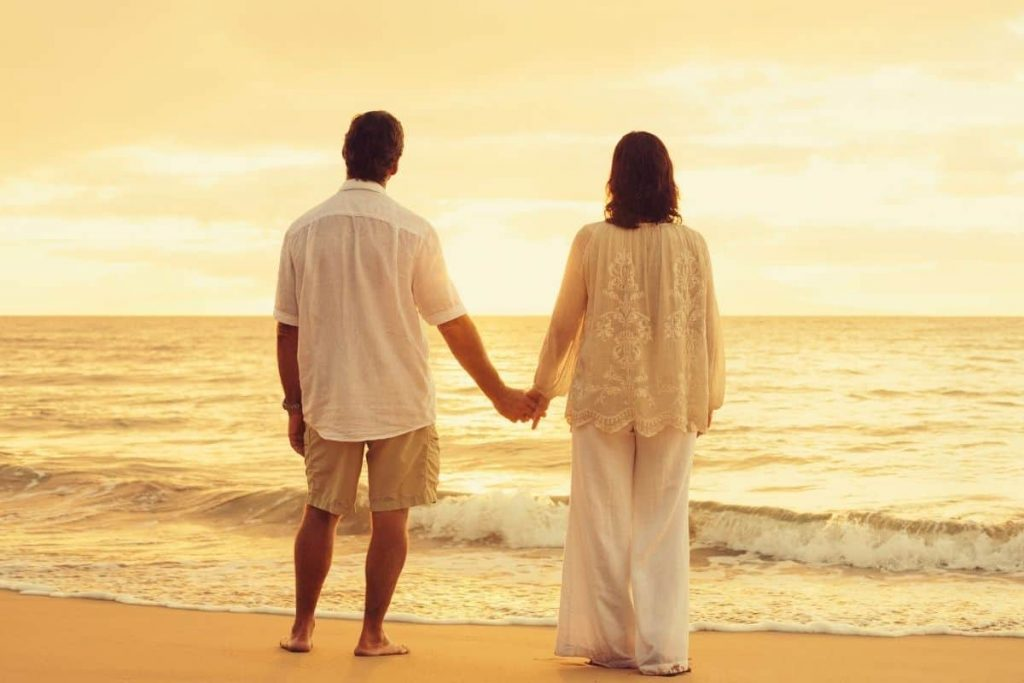 Independently wealthy couple on beach