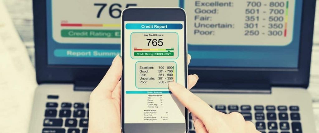 Woman checking credit score on phone