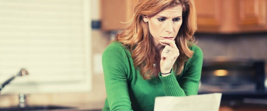 Woman checking bank statement