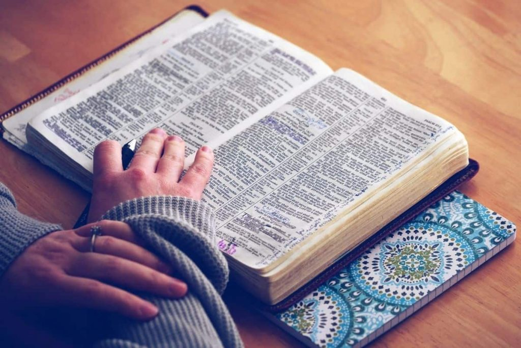 Woman reading scriptures on debt freedom