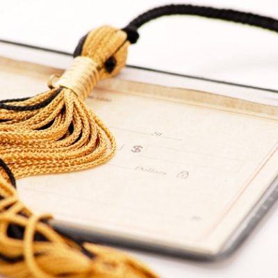 Checkbook and tassle