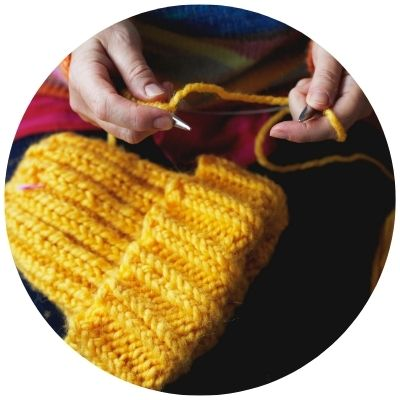 Woman knitting for Etsy