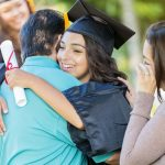 Parent hugging college grad after not paying for kids' college