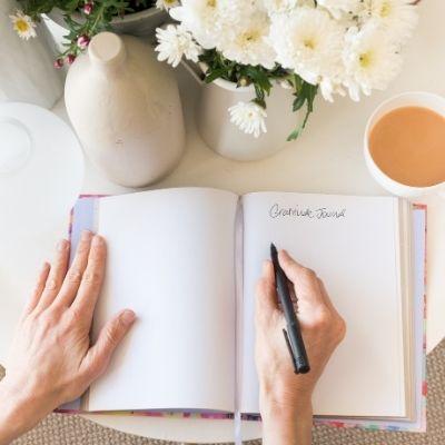 Woman journaling about gratitude
