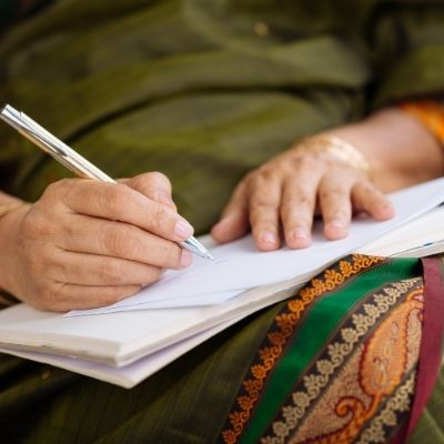 Woman writing a legacy letter