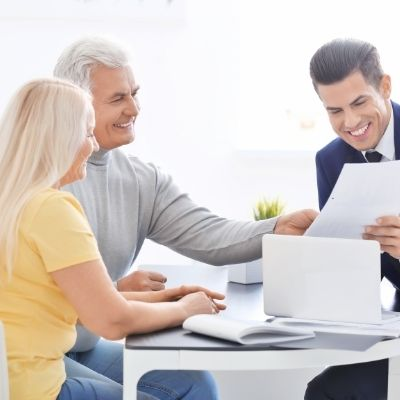 Couple talking to estate planning attorney
