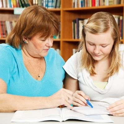 Mom helping daughter with school