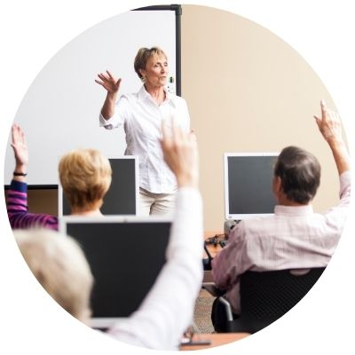 Woman teaching adults