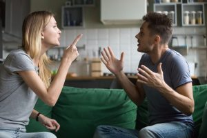 A couple arguing about how to resolve money issues in marriage