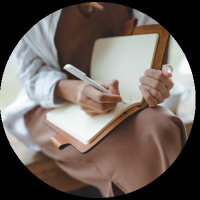 Woman journaling progress