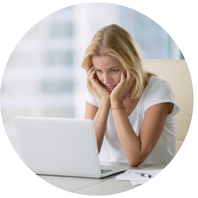 Worried woman looking at laptop
